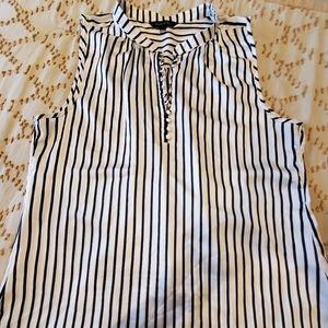Navy blue and white sleeveless blouse